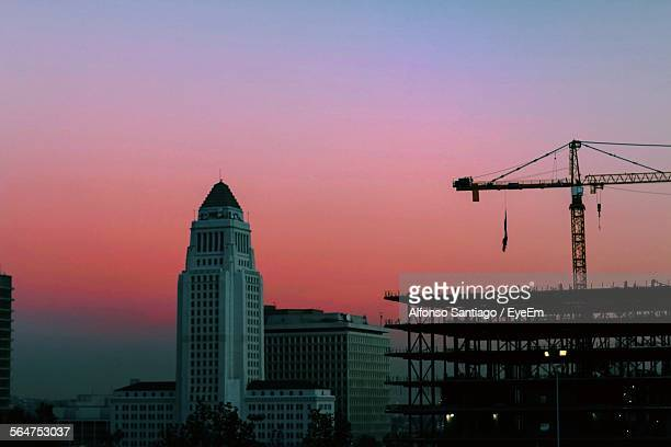 Skyscrapers With Construction Building During Sunset