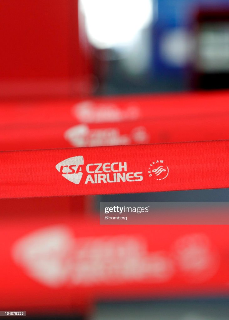 A Skyteam logo sits on a belt barrier at the Ceske Aerolinie AS (CSA) airline check-in desks at Vaclav Havel airport in Prague, Czech Republic, on Monday, March 25, 2013. Korean Air Lines Co. pledged to hold its stake in Ceske Aerolinie AS for five years, while CSA's majority owner will refrain from making 'significant' changes in its strategy, according to terms of this week's sale. Photographer: Martin Divisek/Bloomberg via Getty Images