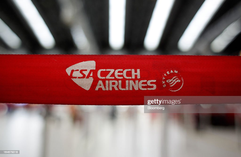 A Skyteam logo sits on a belt barrier at the Ceske Aerolinie AS (CSA) airlines check-in desks at Vaclav Havel airport in Prague, Czech Republic, on Monday, March 25, 2013. Korean Air Lines Co. pledged to hold its stake in Ceske Aerolinie AS for five years, while CSA's majority owner will refrain from making 'significant' changes in its strategy, according to terms of this week's sale. Photographer: Martin Divisek/Bloomberg via Getty Images