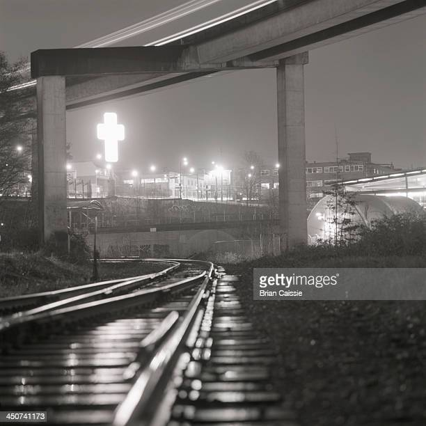 SkyTrain lines and railway track  with 'East-Van' sign in background in Vancouver, Canada,