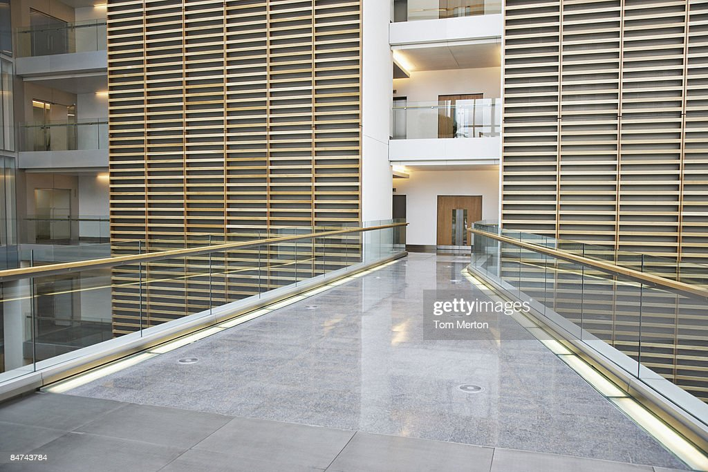 Skywalk in modern office building : Stock Photo
