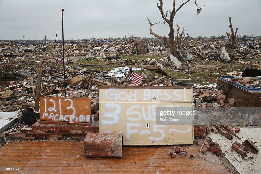 A slab is all that remains of a tornado-damaged home on May 26, 2013 in Moore, Oklahoma. Residents and volunteers continue to search for possessions and clear debris from homes damaged or destroyed in the May 20 tornado which killed at least 24 people. U.S. President Barack Obama is expected to tour the area later today.
