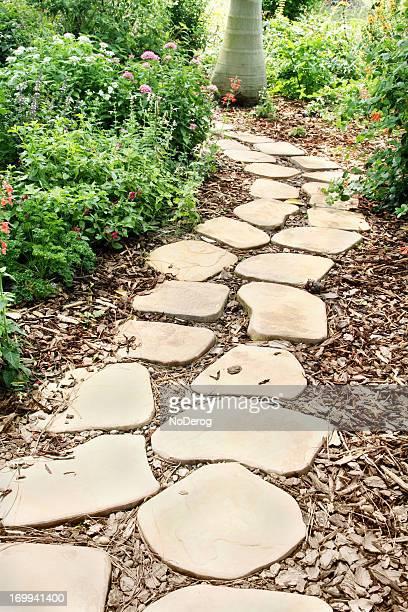 Slab stone footpath through garden