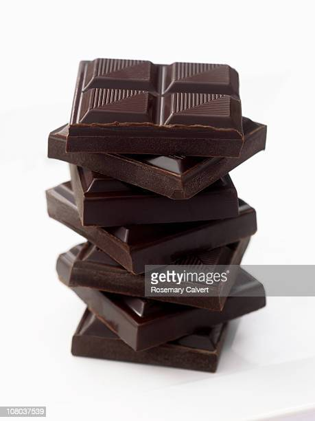 Slabs of chocolate piled up to form tower.