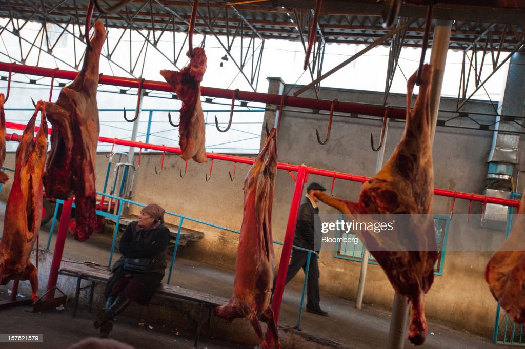 Slabs of mutton hang on display at Osh bazaar in Bishkek, Kyrgyzstan, on Thursday, Nov. 8, 2012. Landlocked Kyrgyzstan is the only country in the world that hosts both Russian and U.S. military bases. Photographer: Noriko Hayashi/Bloomberg via Getty Images