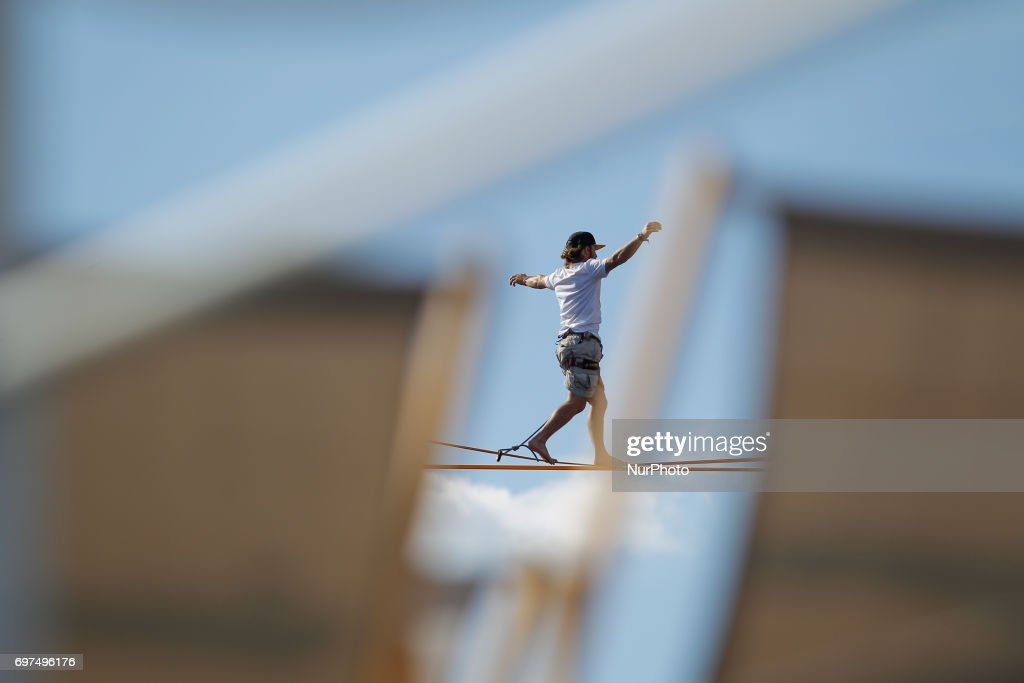 Slacklline competitors are seen on a highline above the river Brda during the annual slackline competition on 18 June, 2017.
