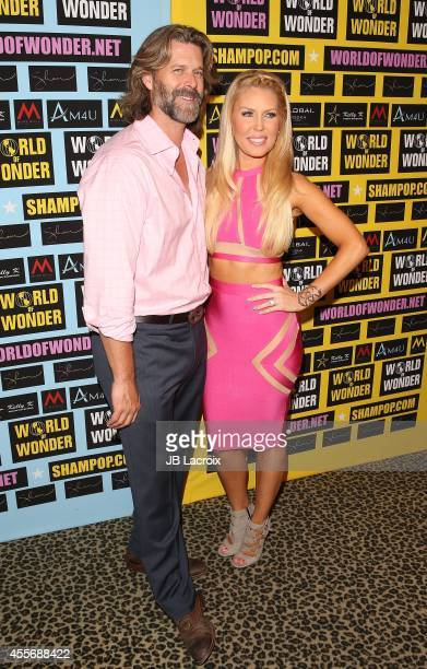 Slade Smiley Rossi and Gretchen Rossi attend a private art exhibition of Hollywood's favorite Pop Culture artist Sham Ibrahim on September 18 in...