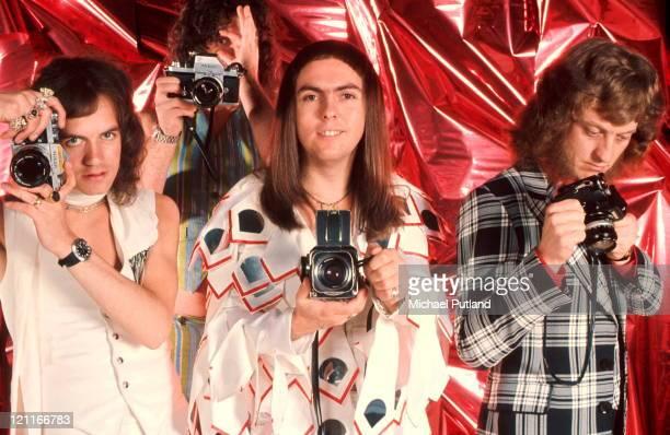 Slade studio group portrait holding cameras London LR Jim Lea Don Powell Dave Hill Noddy Holder