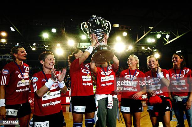 Slagelse raise the trophy as they celebrate their victory against the Odar Krim after the final match of the woman`s handball league championship in...
