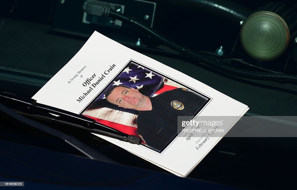 Slain Riverside policeman Michael Crain is eulogized in a program for his memorial service at the Grove Community Church in Riverside, California, on February 13, 2013. Law enforcement personnel from across the state, including local dignitaries, military veterans, colleagues, friends and loved ones of Crain gathered to pay their final respects to the policeman killed last week in what the city's police chief described as a 'cowardly ambush.'' Crain was fatally shot February 7 when he and his partner ran afoul of fugitive Christopher Jordan Dorner. AFP PHOTO / Frederic J. BROWN