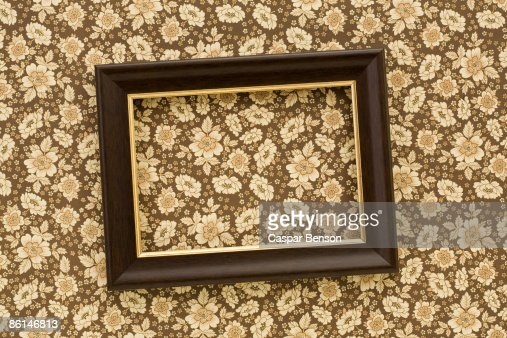A slanted picture frame hanging on a wall