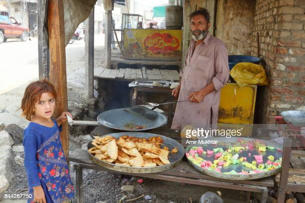 Slanty And Other Fried Food Shops Near Flood Affected Camps