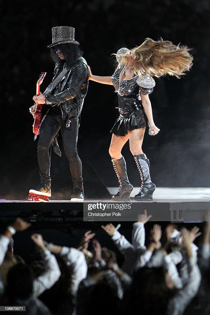 Slash and Fergie of The Black Eyed Peas perform during the Bridgestone Super Bowl XLV Halftime Show at Dallas Cowboys Stadium on February 6, 2011 in Arlington, Texas.