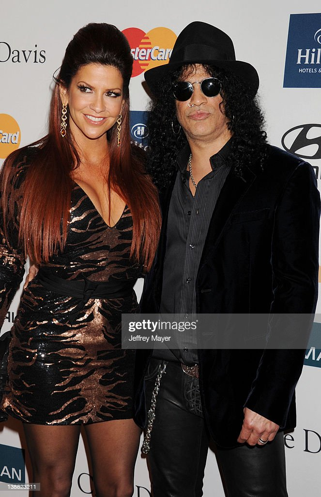 Slash and <a gi-track='captionPersonalityLinkClicked' href=/galleries/search?phrase=Perla+Ferrar&family=editorial&specificpeople=233501 ng-click='$event.stopPropagation()'>Perla Ferrar</a> arrives at the Clive Davis and The Recording Academy's 2012 Pre-GRAMMY Gala and Salute to Industry Icons Honoring Richard Branson at The Beverly Hilton hotel on February 11, 2012 in Beverly Hills, California.