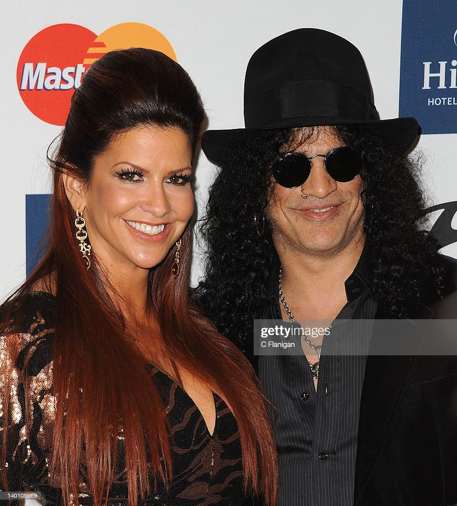 Slash and Wife <a gi-track='captionPersonalityLinkClicked' href=/galleries/search?phrase=Perla+Ferrar&family=editorial&specificpeople=233501 ng-click='$event.stopPropagation()'>Perla Ferrar</a> arrive at Clive Davis and The Recording Academy's 2012 Salute To Industry Icons Gala at The Beverly Hilton hotel on February 11, 2012 in Beverly Hills, California.