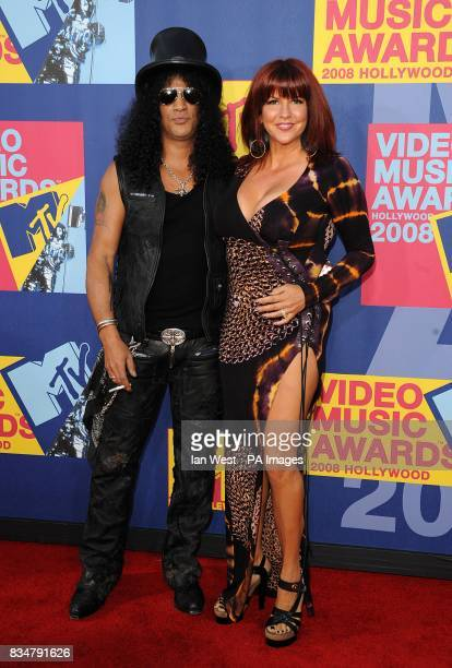 Slash and wife Perla Ferrar arrive for the MTV Video Music Awards 2008 at Paramount Studios Hollywood Los Angeles California