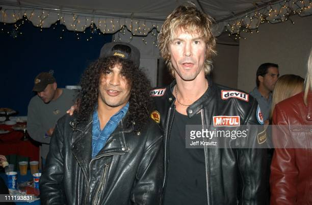 Slash Duff McKagan during KROQ Almost Acoustic Christmas Concert at Universal Amphitheater in Universal City CA United States