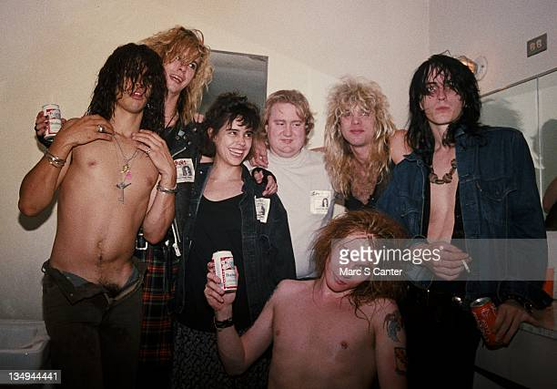 Slash Duff McKagan Teresa Ensenat Tom Zutaut Axl Rose Steven Adler and Izzy Stradlin of the rock group 'Guns n' Roses' backstage at the Santa Monica...