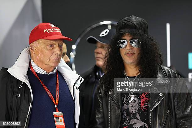 Slash of Guns n Roses with Mercedes GP nonexecutive chairman Niki Lauda in the Mercedes garage before the Formula One Grand Prix of Brazil at...