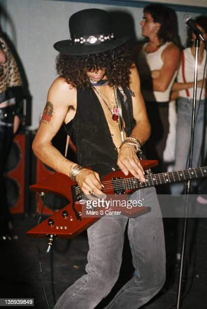 Slash of the rock band 'Guns n' Roses' performs onstage at a UCLA frat party where they played 'Welcome To The Jungle' for the second time for 30...