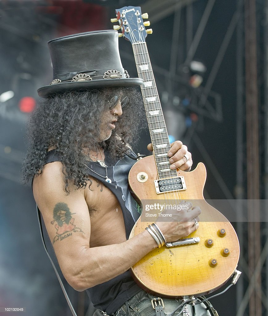 Slash performs on stage on the last day of Download Festival at Donington Park on June 13, 2010 in Castle Donington, England. He plays a Gibson Les Paul guitar.