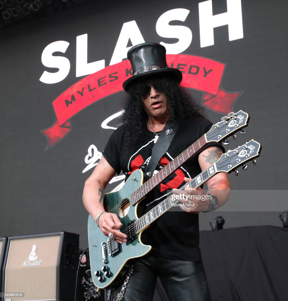 Slash performs onstage at Nikon at Jones Beach Theater on July 10, 2014 in Wantagh, New York.