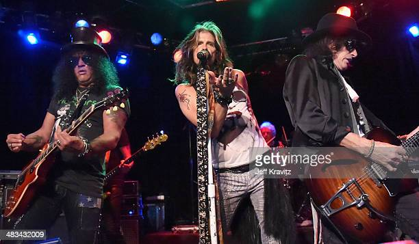 Slash Steven Tyler Joey Kramer and Joe Perry perform onstage during Aerosmith's summer 'Let Rock Rule' tour launch at Whisky a Go Go on April 8 2014...