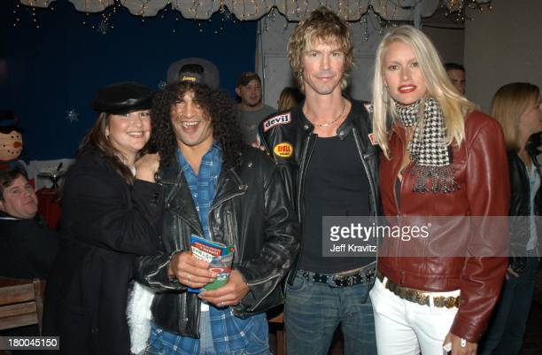 Slash Wife with Duff McKagan Wife during KROQ Almost Acoustic Christmas Concert at Universal Amphitheater in Universal City CA United States