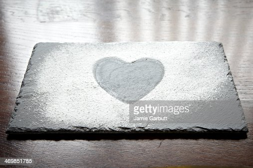 Slate with a icing sugar heart shape