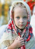 Portrait of  blue-eyed Slavic girl in national scarf
