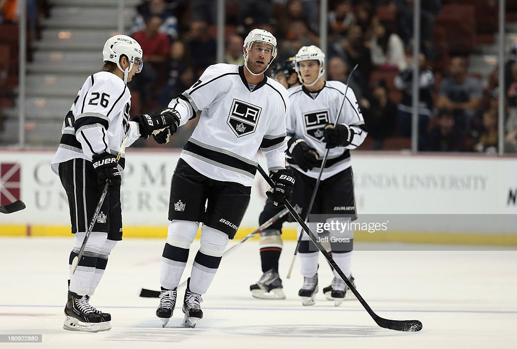 <a gi-track='captionPersonalityLinkClicked' href=/galleries/search?phrase=Slava+Voynov&family=editorial&specificpeople=8315719 ng-click='$event.stopPropagation()'>Slava Voynov</a> (L) #26 of the Los Angeles Kings congratulates <a gi-track='captionPersonalityLinkClicked' href=/galleries/search?phrase=Jeff+Carter&family=editorial&specificpeople=227320 ng-click='$event.stopPropagation()'>Jeff Carter</a> #77 on his second goal of the third period against the Anaheim Ducks at Honda Center on September 17, 2013 in Anaheim, California. The Kings defeated the Ducks 6-0.