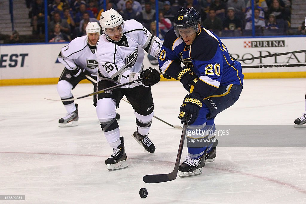 Slava Voynov #26 of the Los Angeles Kings and Alexander Steen #20 of the St. Louis Blues chase down a loos puck in Game One of the Western Conference Quarterfinals during the 2013 NHL Stanley Cup Playoffs at the Scottrade Center on April 30, 2013 in St. Louis, Missouri.