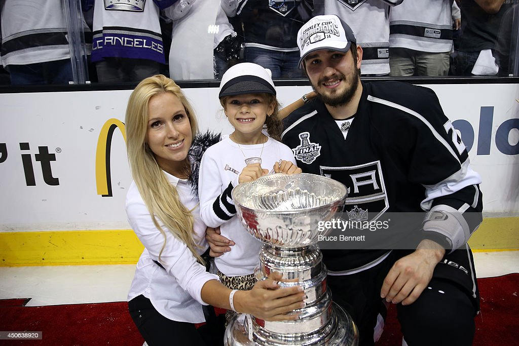 Slava Voynov of the Los Angeles Kings and family celebrate after the Kings win the Stanley Cup after defeating the Rangers 32 in double overtime...