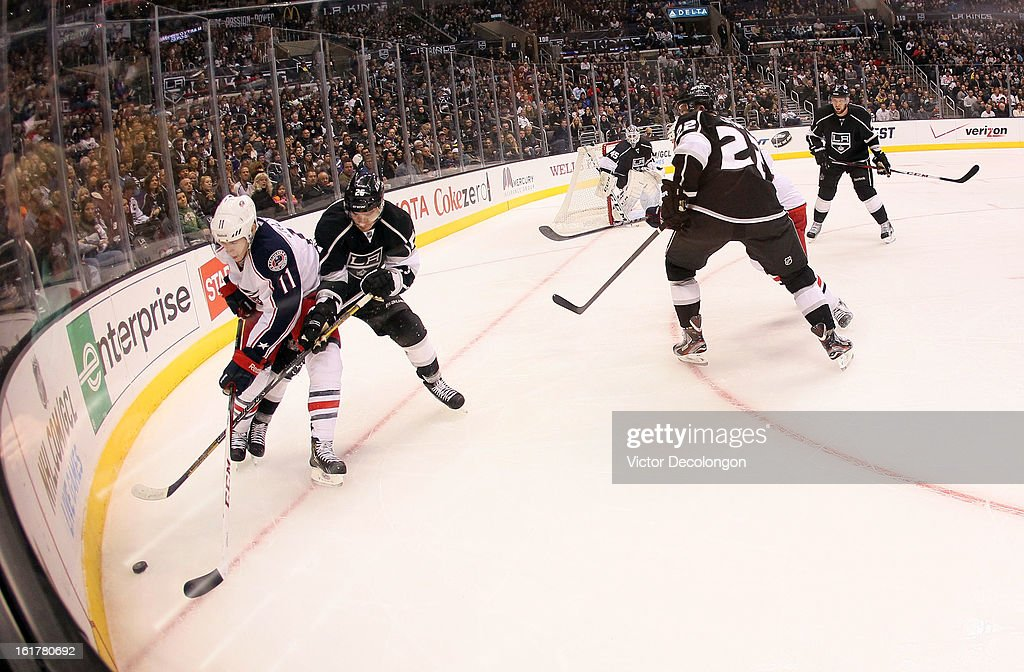 <a gi-track='captionPersonalityLinkClicked' href=/galleries/search?phrase=Slava+Voynov&family=editorial&specificpeople=8315719 ng-click='$event.stopPropagation()'>Slava Voynov</a> #26 of the Los Angeles Kings and Matt Calvert #11 of the Columbus Blue Jackets vie for the puck in the corner during the NHL game at Staples Center on February 15, 2013 in Los Angeles, California. The Kings defeated the Blue Jackets 2-1.