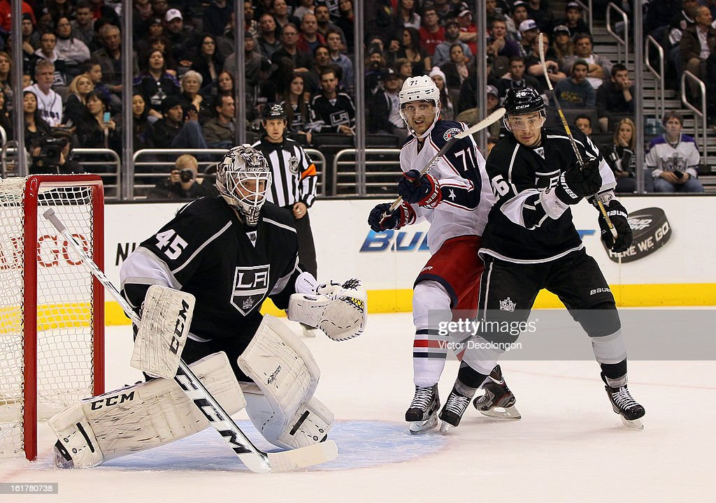 <a gi-track='captionPersonalityLinkClicked' href=/galleries/search?phrase=Slava+Voynov&family=editorial&specificpeople=8315719 ng-click='$event.stopPropagation()'>Slava Voynov</a> #26 of the Los Angeles Kings and <a gi-track='captionPersonalityLinkClicked' href=/galleries/search?phrase=Nick+Foligno&family=editorial&specificpeople=537821 ng-click='$event.stopPropagation()'>Nick Foligno</a> #71 of the Columbus Blue Jackets vie for position in the low slot area as goaltender <a gi-track='captionPersonalityLinkClicked' href=/galleries/search?phrase=Jonathan+Bernier&family=editorial&specificpeople=540491 ng-click='$event.stopPropagation()'>Jonathan Bernier</a> #45 of the Los Angeles Kings faces the play during the NHL game at Staples Center on February 15, 2013 in Los Angeles, California. The Kings defeated the Blue Jackets 2-1.