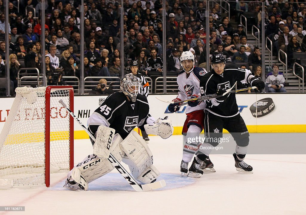 Slava Voynov #26 of the Los Angeles Kings and Nick Foligno #71 of the Columbus Blue Jackets vie for position in the low slot area as goaltender Jonathan Bernier #45 of the Los Angeles Kings faces the play during the NHL game at Staples Center on February 15, 2013 in Los Angeles, California. The Kings defeated the Blue Jackets 2-1.