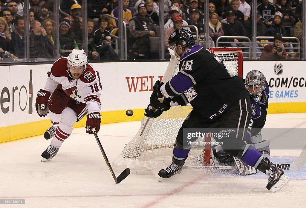 <a gi-track='captionPersonalityLinkClicked' href=/galleries/search?phrase=Slava+Voynov&family=editorial&specificpeople=8315719 ng-click='$event.stopPropagation()'>Slava Voynov</a> #26 of the Los Angeles Kings backhands the puck behind the net from <a gi-track='captionPersonalityLinkClicked' href=/galleries/search?phrase=Shane+Doan&family=editorial&specificpeople=201614 ng-click='$event.stopPropagation()'>Shane Doan</a> #19 of the Phoenix Coyotes as goaltender <a gi-track='captionPersonalityLinkClicked' href=/galleries/search?phrase=Jonathan+Quick&family=editorial&specificpeople=2271852 ng-click='$event.stopPropagation()'>Jonathan Quick</a> #32 of the Los Angeles Kings defends the right side of his net during their NHL game at Staples Center on March 18, 2013 in Los Angeles, California. The Kings defeated the Coyotes 4-0.