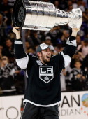 Slava Voynov of the Los Angeles Kings celebrates as he lifts the Stanley Cup after the Kings won Game Five 32 in double overtime over the New York...