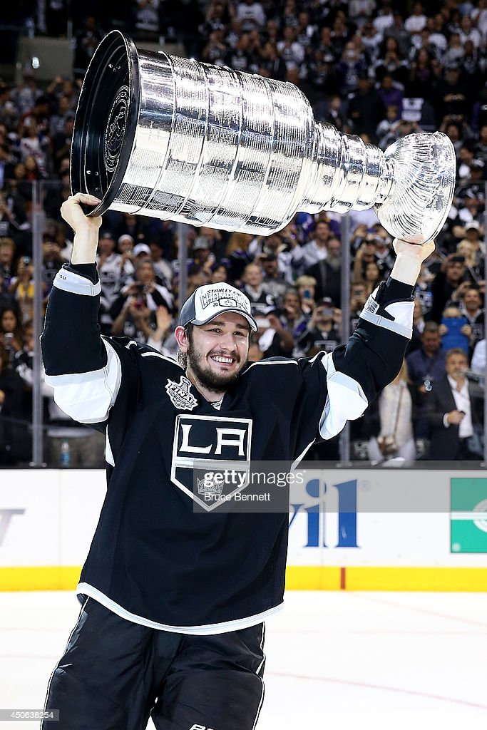 Slava Voynov of the Los Angeles Kings celebrates with the Stanley Cup after the Kings 32 double overtime victory against the New York Rangers in Game...