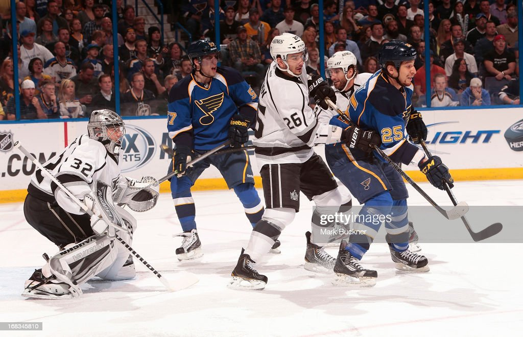 <a gi-track='captionPersonalityLinkClicked' href=/galleries/search?phrase=Slava+Voynov&family=editorial&specificpeople=8315719 ng-click='$event.stopPropagation()'>Slava Voynov</a> #26 of the Los Angeles Kings defends against Chris Stewart #25 of the St. Louis Blues in Game Five of the Western Conference Quarterfinals during the 2013 NHL Stanley Cup Playoffs on May 8, 2013 at Scottrade Center in St. Louis, Missouri.