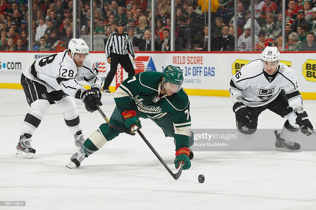 <a gi-track='captionPersonalityLinkClicked' href=/galleries/search?phrase=Slava+Voynov&family=editorial&specificpeople=8315719 ng-click='$event.stopPropagation()'>Slava Voynov</a> #26 of the Los Angeles Kings defends while his teammate <a gi-track='captionPersonalityLinkClicked' href=/galleries/search?phrase=Jarret+Stoll&family=editorial&specificpeople=204632 ng-click='$event.stopPropagation()'>Jarret Stoll</a> #28 is called for a hooking penalty against <a gi-track='captionPersonalityLinkClicked' href=/galleries/search?phrase=Matt+Cullen&family=editorial&specificpeople=536122 ng-click='$event.stopPropagation()'>Matt Cullen</a> #7 of the Minnesota Wild during the game on March 30, 2013 at the Xcel Energy Center in Saint Paul, Minnesota.