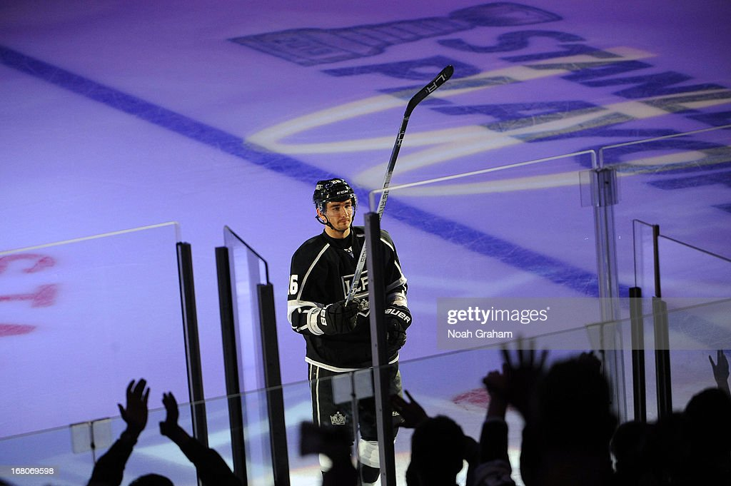 Slava Voynov #26 of the Los Angeles Kings gives his stick to a fan after defeating the St. Louis Blues in Game Three of the Western Conference Quarterfinals during the 2013 NHL Stanley Cup Playoffs at Staples Center on May 4, 2013 in Los Angeles, California.