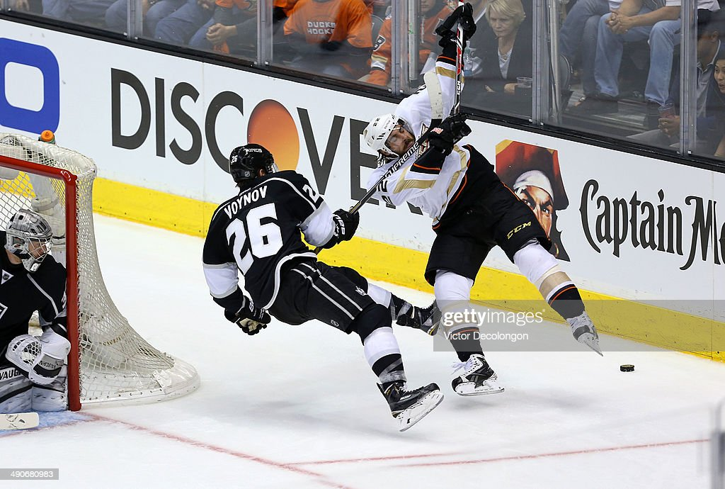 Slava Voynov of the Los Angeles Kings high sticks Mathieu Perreault of the Anaheim Ducks behind the net during third period of Game Six of the Second...