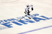 Slava Voynov of the Los Angeles Kings passes the puck during the third period of Game Three of the 2014 NHL Stanley Cup Final at Madison Square...