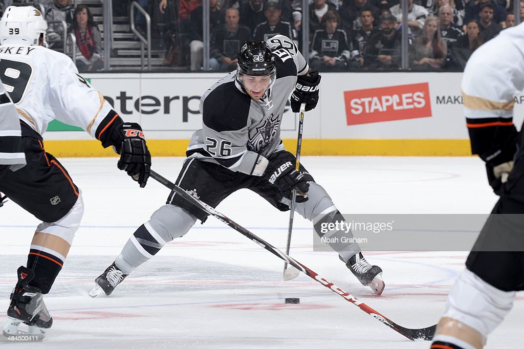 Slava Voynov #26 of the Los Angeles Kings skates with the puck against the Anaheim Ducks at Staples Center on April 12, 2014 in Los Angeles, California.
