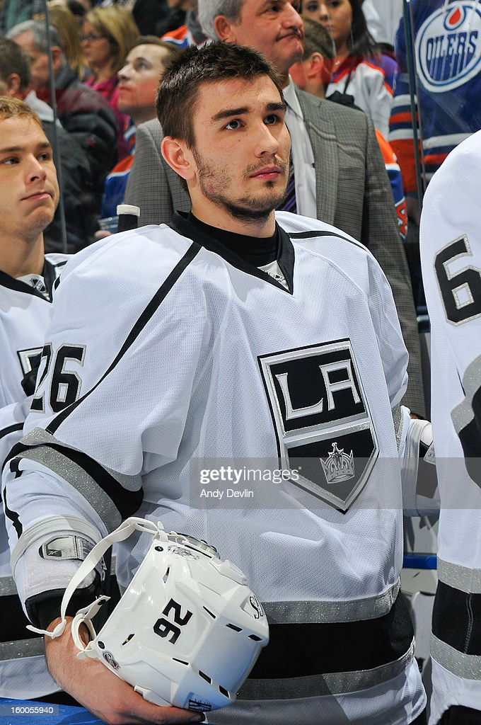 Slava Voynov #26 of the Los Angeles Kings stand for the singing of the national anthem prior to a game against the Edmonton Oilers at Rexall Place on January 24, 2013 in Edmonton, Alberta, Canada.