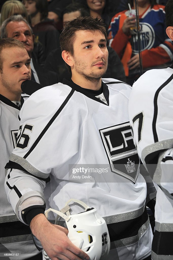 Slava Voynov of the Los Angeles Kings stands for the singing of the national anthem prior to a game against the Edmonton Oilers on March 9 2014 at...