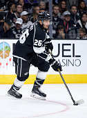 Slava Voynov of the Los Angeles Kings starts a rush during the game against the San Jose Sharks at Staples Center on October 8 2014 in Los Angeles...