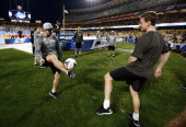 Slava Voynov of the Los Angeles Kings warms up on the field before taking on the Anaheim Ducks in the 2014 Coors Light NHL Stadium Series at Dodger...