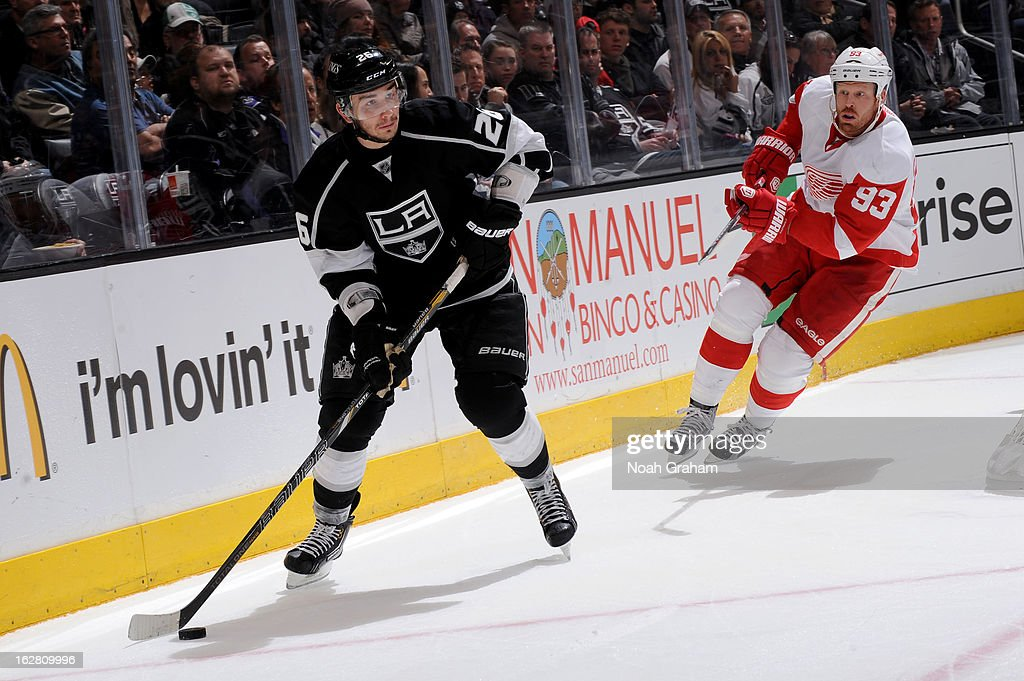 Slava Vynov #26 of the Los Angeles Kings skates with the puck against <a gi-track='captionPersonalityLinkClicked' href=/galleries/search?phrase=Johan+Franzen&family=editorial&specificpeople=624356 ng-click='$event.stopPropagation()'>Johan Franzen</a> #93 of the Detroit Red Wings at Staples Center on February 27, 2013 in Los Angeles, California.